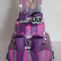 "Hannah Montana 8"" and 6"" two tier cake (my first time using SPS!!) iced in buttercream, with fondant accents. The picture was printed and..."