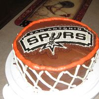 Go Spurs! Spurs basketball hoop cake for my uncle's birthday. He really liked it. It was a german chocolate cake with chocolate buttercream and...