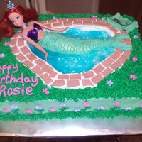 Ariel Swimming Cake This cake was a lot of fun to make!!! I looked at a lot of cakes on cc and came up with this. I made a towel out of fondant and the tail is...