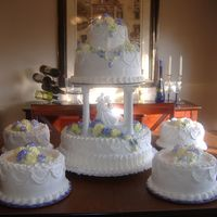 Jerri And Jason's Wedding 3 tier with 4 satilite cakes with yellow and lavender roses made from my homemade buttercreme icing.