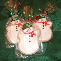 Snowmen Cookies NFSC with royal icing and sugar holly accent.