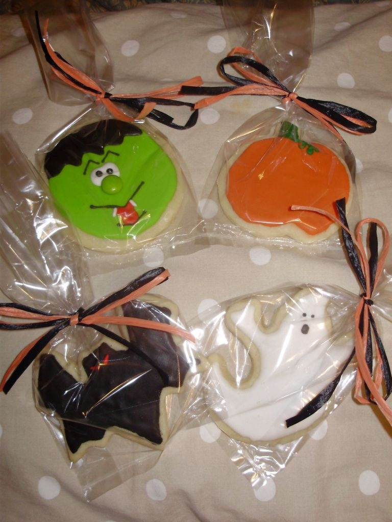 Halloween Cookies NFSC with royal icing. Frank's nose is an M&M. I copied Frank from somone I saw here but cannot remember who. SORRY!