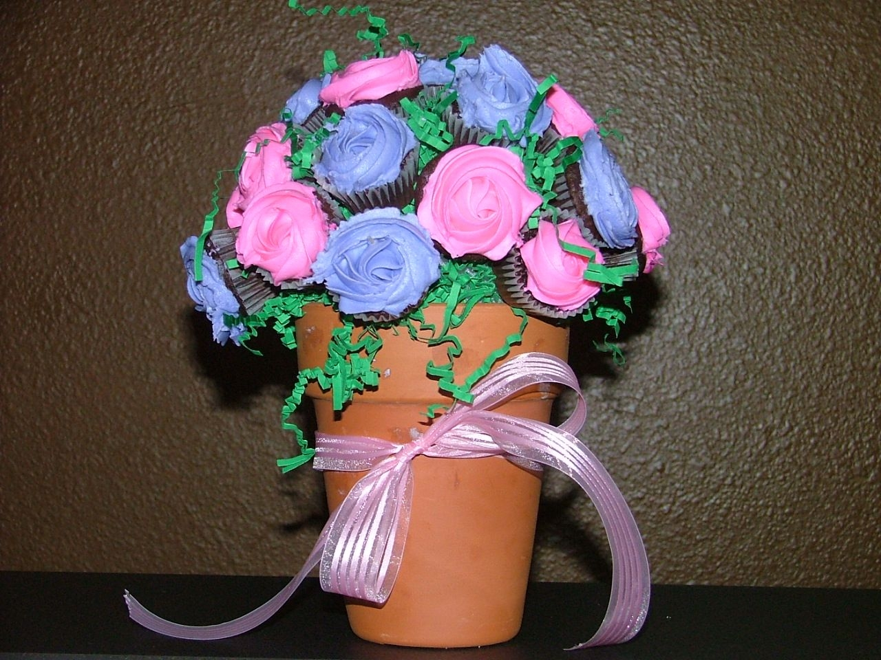 Cupcake Bouquet cupcake bouquet made for first birthday party. Chocolate cupcakes with crusting buttercream frosting. Everyone LOVED these!