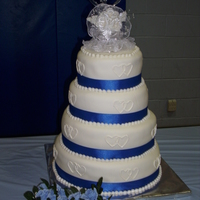 Blue And White Wedding This cake was huge. The cakes are covered in mmf with buttercream hearts and mmf pearls.