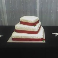 Red And White Wedding Cake is covered in mmf with buttercream accents on the side