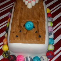 Bowling Cake is covered with mmf. Decorations also made with mmf.