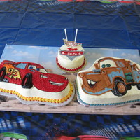 Disney Cars Cakes For Benjamin Lightening McQueen is chocolate fudge with buttercream using a Wilton Pan. Mater and the logo are buttercream transfers and hand carved....