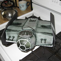 Star Wars Darth Vader 's Tie Fighter Design was copied from an actual toy from toys r us. Vanilla 8x10x2 inch cake is carved and iced in gray vanilla buttercream. Parts of the...