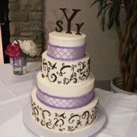Brown Scrolls, Purple Ribbon 6, 8, 10, 12 rounds iced in buttercream with brown free handed scrolls and purple ribbon. The bride hand painted the monagrams.Thanks for...
