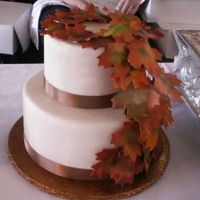 Fall Leaves Dummy My last new dummy for the bridal show. 2 teir stacked covered in ivory fondant with gumpast airbrushed leave and real brown ribbon. Thanks...