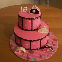"Sweet 16 6 and 10 stacked rounds. Iced in pink buttercream with fondant accents. Purses are cake covered in fondant with royal handles. ""16&..."