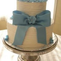 Blue Bow 2 tier round wedding cake (dummy) Blue Bow and flowers done in fondant.