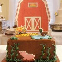 "Farm With Barn 8"" square iced in chocolate buttercream with fondant farm animals. A different one on each side. Piped ""corn stalks""...."
