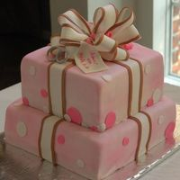 Pink Packages Bridal Shower Cake All fondant with fondant bow, wedding rings, and tag.