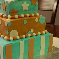 Blue And Brown Baby Shower Cake Buttercream with fondant accents.