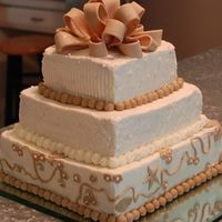 Wedding Shower Cake Buttercream with fondant accents.