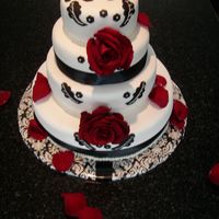 Black And White Wedding Cake The cake is a knock off of the invitation. Cake is white with vanilla BC/raspberry filling, white chocolate fondant with black colored...