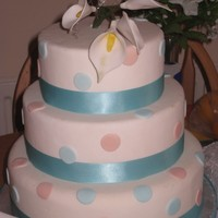 Spotty Wedding Cake spotty fondant iced with sugar arum lilies