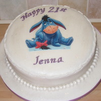 Birthday Cake vanilla cake and filling. edible eeyore on top!