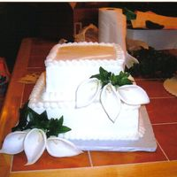 Wedding Cake Lillies white cake with strawberry filling and fresh strawberries and silk lillies
