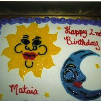 Sun And Moon white cake buttercream iced, with gel sun and moon.