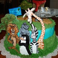 Madagascar Birthday Cake This is a cake I made for my nephew. The Madagascar animals, volcano and trees are all made out of gumpaste and hand painted.
