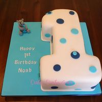 "No.1 Birthday Cake  No.1 shaped from a 9"" square vanilla sponge cake, filled with IMBC and raspberry jam and covered with sugarpaste (fondant). Hand-..."