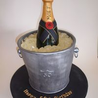Champagne On Ice Cake I made one of these about 6 months ago, but I think this one came ot much better! It is all edible, the bottle is carved from cake and the...