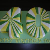 "No. 40 Cake This is a big cake - the board measures 24x14""! The request from the customer was for a 4 & 0 in green white and yellow. All the..."
