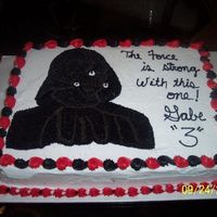 Darth Vader This picture doesn't do the cake justice. The lighting is off and DV looks like a black blob. In person, he is actually trimmed in a...