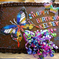 Butterfly Devils food with chocolate ganache. Fondant accents. Butterfly is painted on fondant with gel colors.