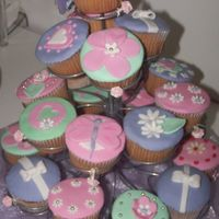 Girly Cupcakes Made for a 2nd Birthday celebration. Vanilla Cakes with white chocolate ganache and fondant.