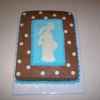 Pregnant Mom Silhouette SIL baby shower. choc BC, fondant accents, 1/2 fudge filling & 1/2 caramel filling on yellow cake. Not quite sure why is doesn't...