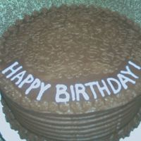 Chocolate Birthday Cake This client asked for a yellow cake with chocolate icing. They loved the taste.