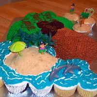 Luau Cake buttercream, graham crumbs for beach, water piping gel over blue bc