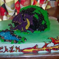 Dragon Cake For My Nephew Buttercream, colorflow, a bit of carving for the cave...