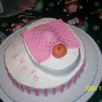 Baptism Cake This is the second cake for the baptism. The baby and the blanket is fondant, and everything else is buttercream. Im SO terrible at taking...