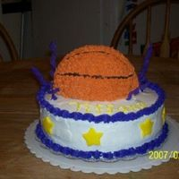 Basketball Birthday Cake  my FIRST paid cake!! I found this on the Wilton site. It didnt turn out as good as I would have liked.. and the curlies keep breaking. but...