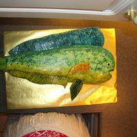 Dolphin Fish Yellow cake BC filling covered in BC then MMF, fins are Satin Ice Fondant, Had trouble with Tail. Thanks for the idea to look at the...