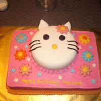 "Hello Kitty Yellow Butter Cake with Vanilla Butter Cream, 6"" Yellow Cake w/ Satin Ice Fondant, Candy Melt Flowersand Sugar Flowers."