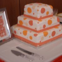 Orange Dots I did this one for my cousin's wedding. my first wedding cake, first tiered cake, first time working with fondant. I think it turned...