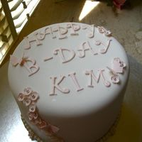Img_4851.jpg   Chocolate cake with peanut butter filling. Covered in satin ice with gum paste decorations.