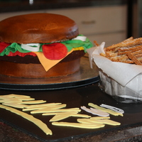 Hamburger Cake Hamburger Cake and french fries I made for my son's restaurant opening. Fries are sugar cookies.