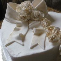 Anniversary Cake   25th Ann. Cake. Buttercream with gum paste roses and fondant bow.