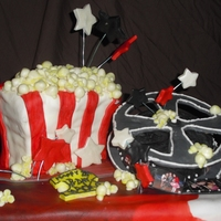 Popcorn & A Movie Made out of pound cake. Popcorn made with fondant and colored with yellow petal dust. Stars and movie ticket are made out of fondant too. I...