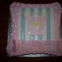 Baby Princess This cake was for a baby shower. Customer found a picture somewhere on the internet and wanted me to replicate it exactly as it was. I...