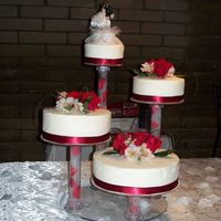"Wedding Cake 6"", 8"", 10"" and 12"" rounds (all different flavors) iced in whipped cream and topped with fresh flowers."