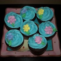 Cupcakes Chocolate cupcakes with swirl of BC, topped with royal icing drop flowers.