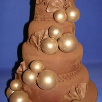 Golden Bauble Chocolate Cake can't seem to post an answer - keep getting error message.It was belgian chocolate paste [not sugarpaste] and then dusted with cocoa...