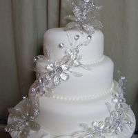 'bling' Wedding Cake Just finished this three tier covered with ivory sugarpasteJust jewels and 'bling' to decorate